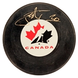 John Tavares Autographed Team Canada Hockey Puck (Frameworth)
