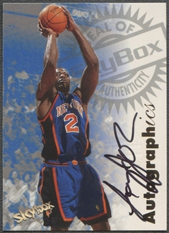 1997/98 SkyBox Premium #58 Larry Johnson Autographics Auto