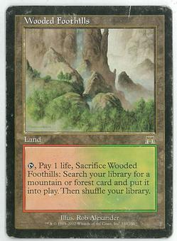Magic the Gathering Onslaught Single Wooded Foothills - HEAVY PLAY (HP)